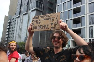 """Climate strike in Melbourne, AUS. Person holding sign with Simpson's quote """"Won't somebody please think of the children!"""""""